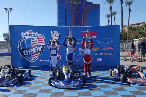 benik kart with kart at the podium